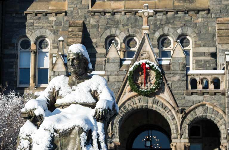 John Carol Statue in the snow